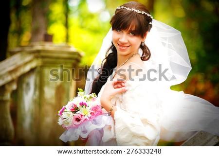 Bride  in a park  - stock photo