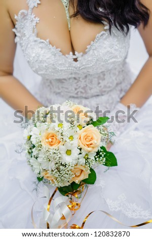 Bride in a park. wedding dress. Bridal wedding bouquet of flowers
