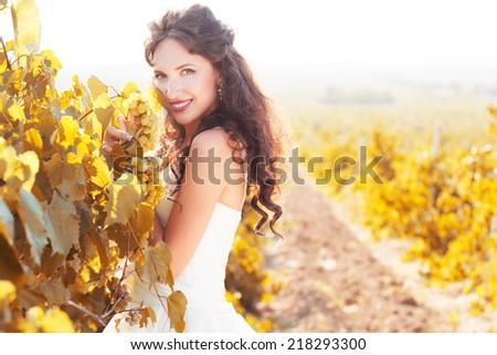 Bride in a vineyard, autumn - stock photo