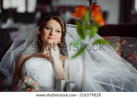 bride in a white dress with a bouquet in hands