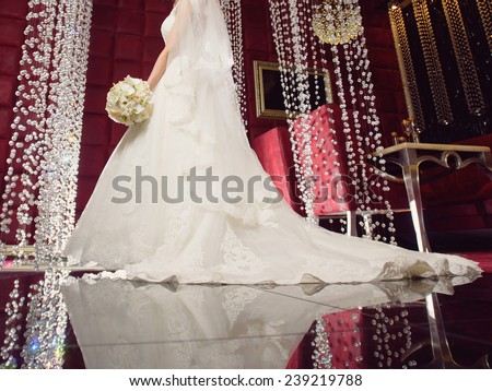 bride in dress with long tail at restaurant - stock photo