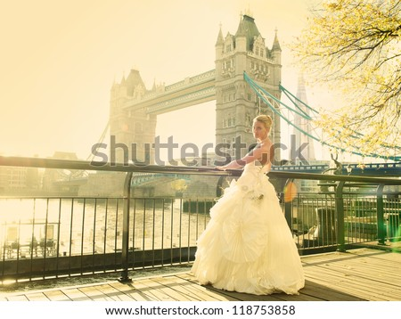Bride in front to tower bridge - stock photo