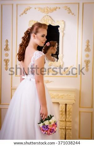 Bride in long white beautiful dress, studio shot - stock photo