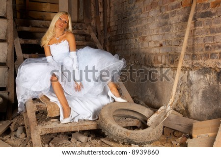 Bride in the basement of old building