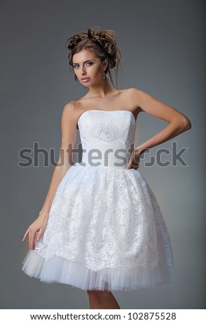 Bride in white couture wedding dress on isolated grey background. Catalog shot in the Studio - stock photo