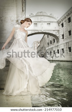 Bride in white gown / bridal dress in Venice Italy, near the Bridge of Sighs. - stock photo