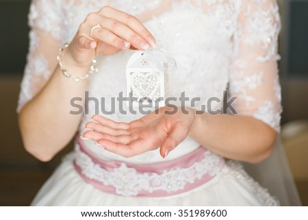 Bride is holding a box in his hands