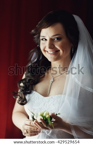 Bride is waiting groom, smiling charmingly - stock photo