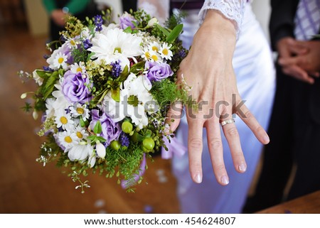 Bride just married, woman hand with wedding ring