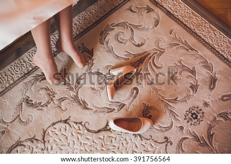 Bride legs and shoes from her - stock photo