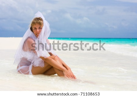 Bride on a coastline at tropical beach