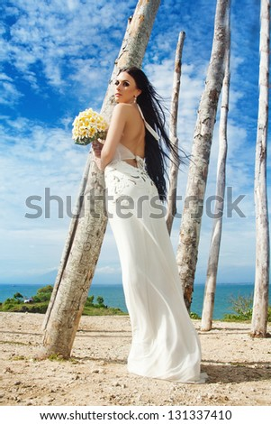 Bride on exotic decoration - bali - stock photo