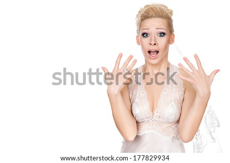 Bride opened her mouth in surprise and waving his hands on his eyes wide. - stock photo