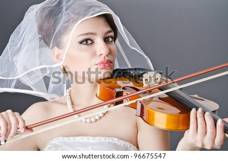 Bride playing violin in studio