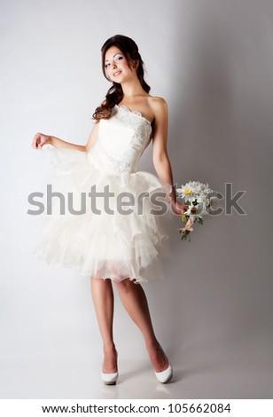 Bride portrait in studio on white background - stock photo