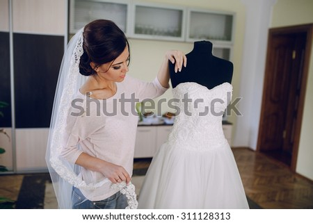bride preparing for her wedding in style green