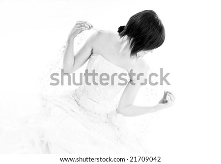 Bride preparing her veil in a soft high key light, isolated on white - stock photo