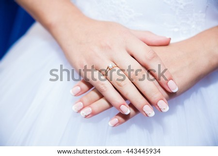 bride's hands with wedding rings close up