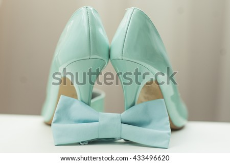 bride's shoes, tie butterfly - stock photo