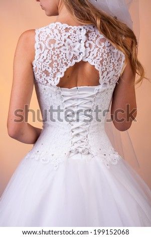 Bride's wedding dress with crystals and lacing - stock photo