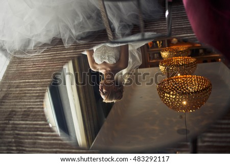 Bride sitting in a luxurious restaurant alone
