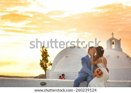 bride sitting in the sun and gently kissing - stock photo