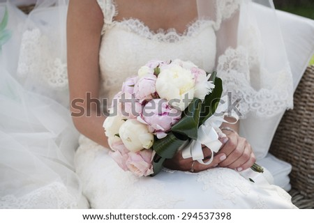 bride sitting with decorated flowers wedding bouquet