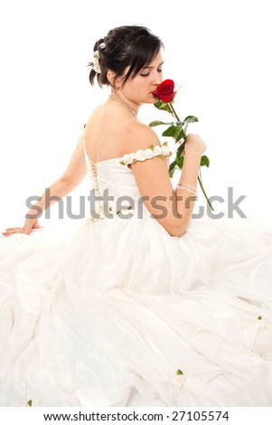 Bride sniffing a red rose