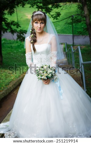 Bride standing on a staircase - stock photo