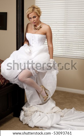 Bride Striptease Series #6 - stock photo