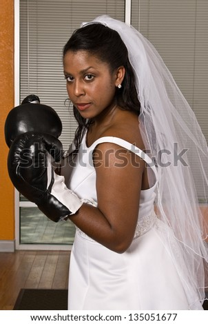 Bride wearing boxing gloves