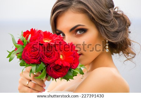 Bride with a bouquet of flowers - stock photo