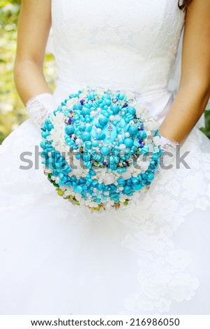 bride with a bouquet of turquoise stones - stock photo