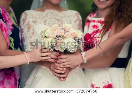 bride with a white bouquet and bridesmaids - stock photo