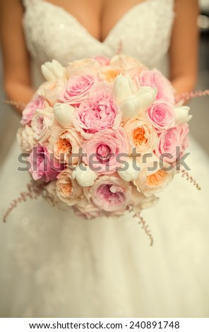 Bride with bouquet in hands.close up - stock photo