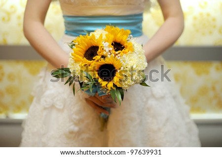 Bride with bouquet of sunflowers in hands - stock photo