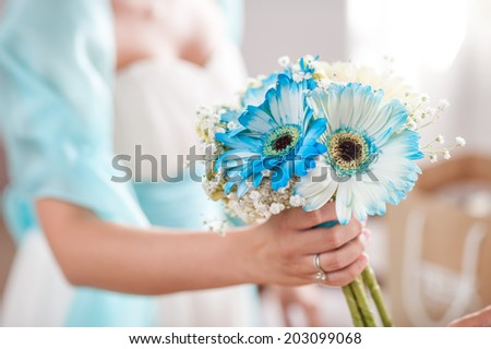 bride with bouquet of white and blue flowers - stock photo