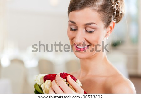 Bride with bridal bouquet in a hall at the wedding day