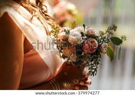 Bride with bridesmaids on the wedding ceremony outdoors