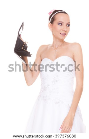 Bride with empty wallet. Young girl holding purse looking for money cash. Wedding expenses costs, expenditure. Finance concept. Woman in white wedding dress isolated on white background.