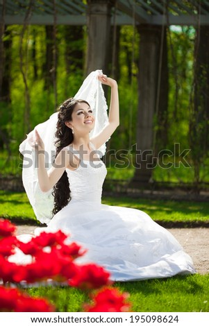 Bride with flowers outdoors