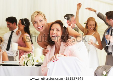 Bride With Grandmother At Wedding Reception - stock photo