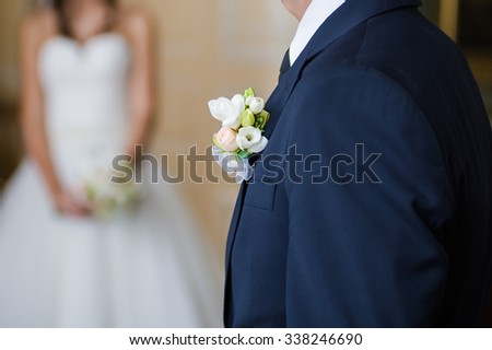 Bride with groom before wedding ceremony