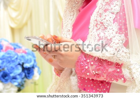 Bride with hand phone