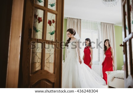 Bride with her bridesmaid in the room - stock photo