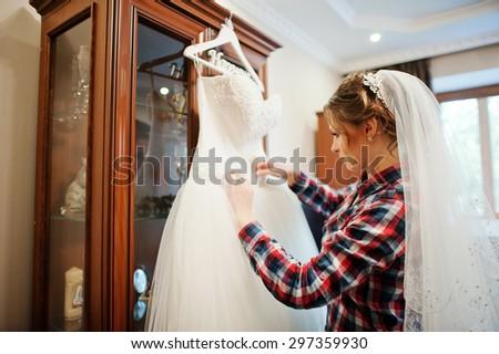 Bride with her wedding dress - stock photo
