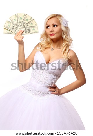 bride with money. beautiful blonde young woman holding dollars bills isolated on white background. concept - stock photo