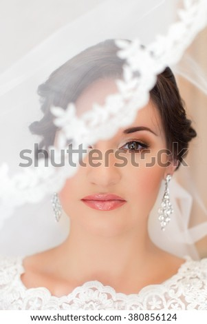 Bride with red lipstick on the lips