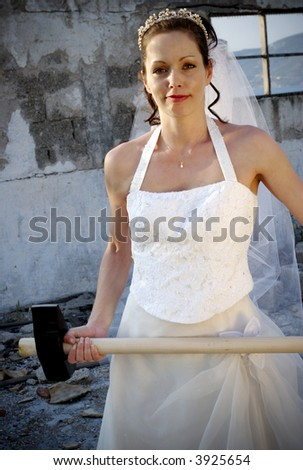 bride with sledge hammer in a smashed up house