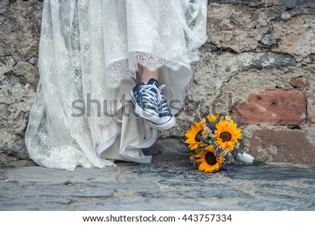 Bride with sport shoes - stock photo